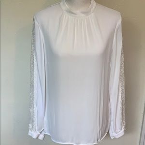 Brooks Brother blouse with ornate sleeve detail.